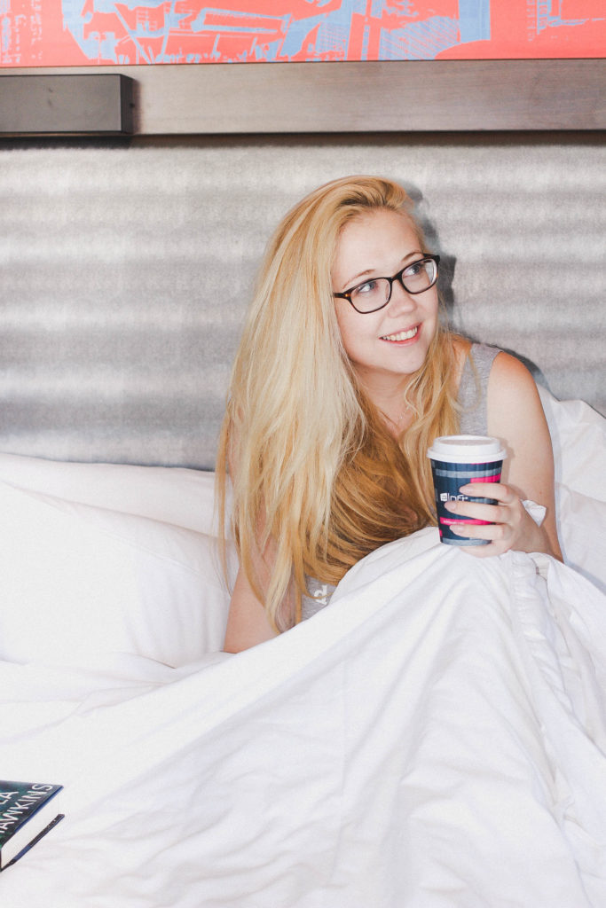 Drinking Coffee In Bed At Aloft Boston Seaport